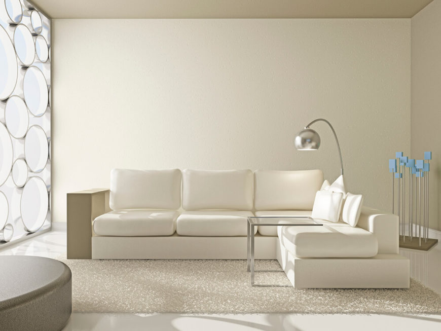 A Predominantly White Living Room With A Plush Area Rug Over A High Gloss  Floor.