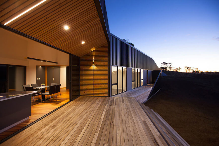 This angle shows a good view of the house and reveals the right side of the exterior. In the interior, the dining room leads into the living spaces and bathrooms of the home. From this angle you can see the size of the patio and the sheltered section of this outdoor space.