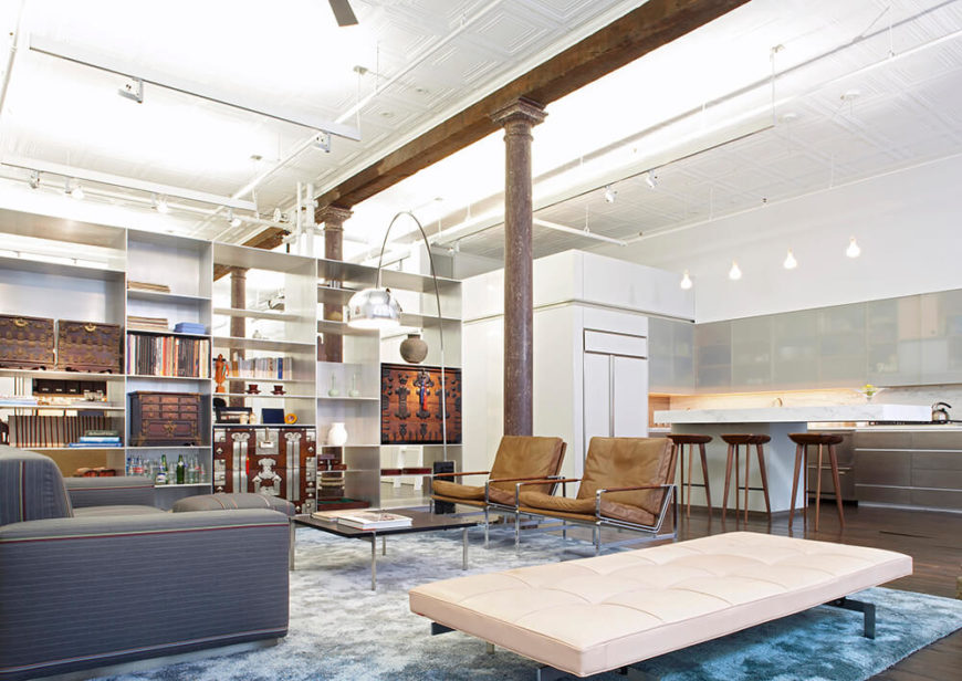 The living room is dominated by a built-in metal display shelf that was designed to house the owners traditional Korean trunk collection. This display also works to divide the three spaces of the loft — living and kitchen, the study, and the sleeping area. The silk rug was custom designed by Slade Architects to fade from blue around the edges to silver in the center.