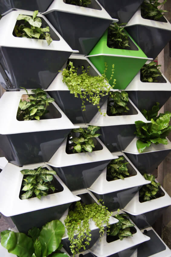 10-vertical-garden Again, stackable plant pots are an incredible and stylish way to utilize space. Perfect for small apartments, stacking your plants in pod-like pots gives them plenty of room to grow and thrive.