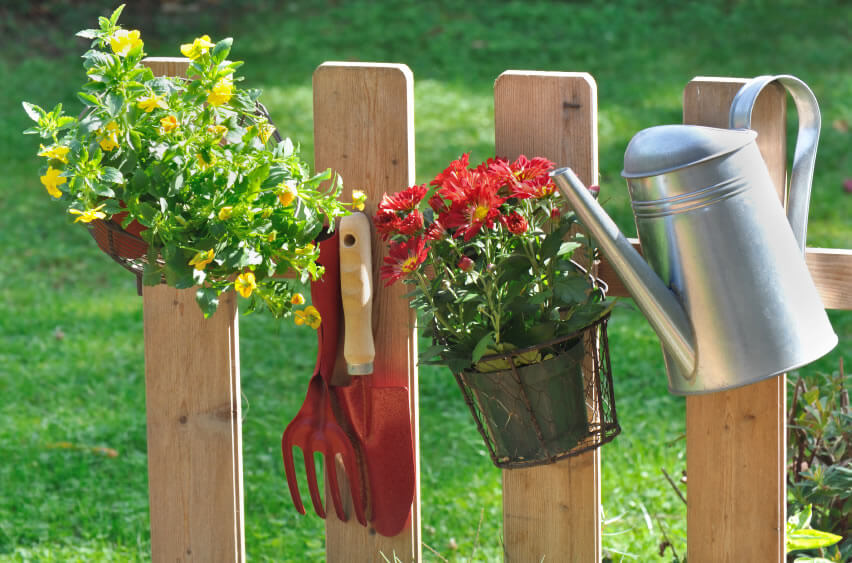 Even the picket fence can get into the act! Perfect for hanging smaller items, such as tools and watering cans, a picket fence also is great for hanging small-pot flowers or those plants transitioning from a spot in the ground to a more-vertically inclined gardening area.