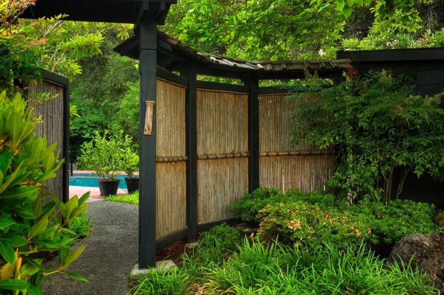 21 bamboo fence ideas for residential houses a curved fence with lacquered black supports has a large gate that opens up to expose workwithnaturefo