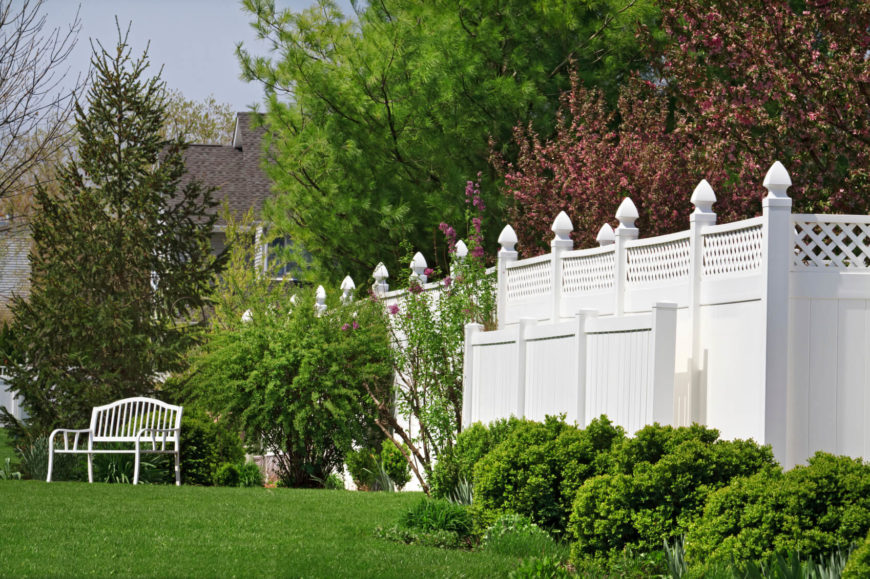 A Tall Vinyl Wood Look Privacy Fence Topped With Lattice For Additional  Style. Tall