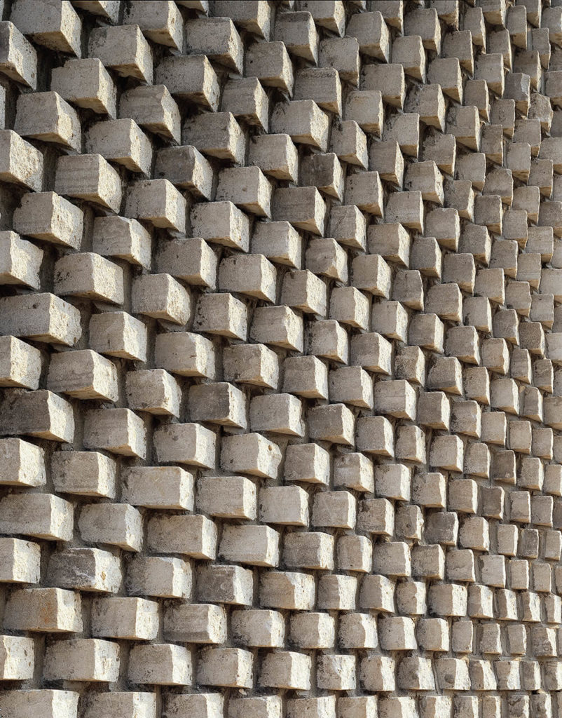 """Here's another look at the intricate """"pixelated"""" brickwork covering the facade of the home. The cumulative effect here is mesmerizing."""