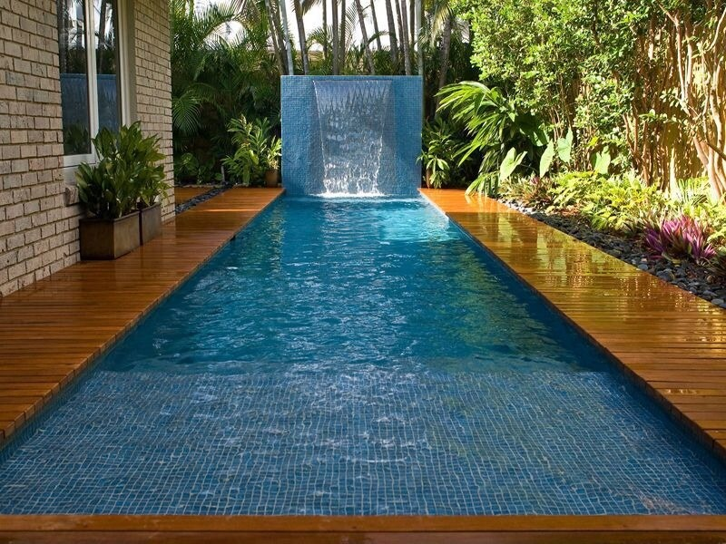 A stunning, if small plunge pool in a rectangular design. At the far end is a large waterfall wall with a cascading arc of water.