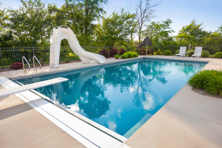 This slide is freestanding and sturdy, resting on the concrete side of the pool and leading into the center.