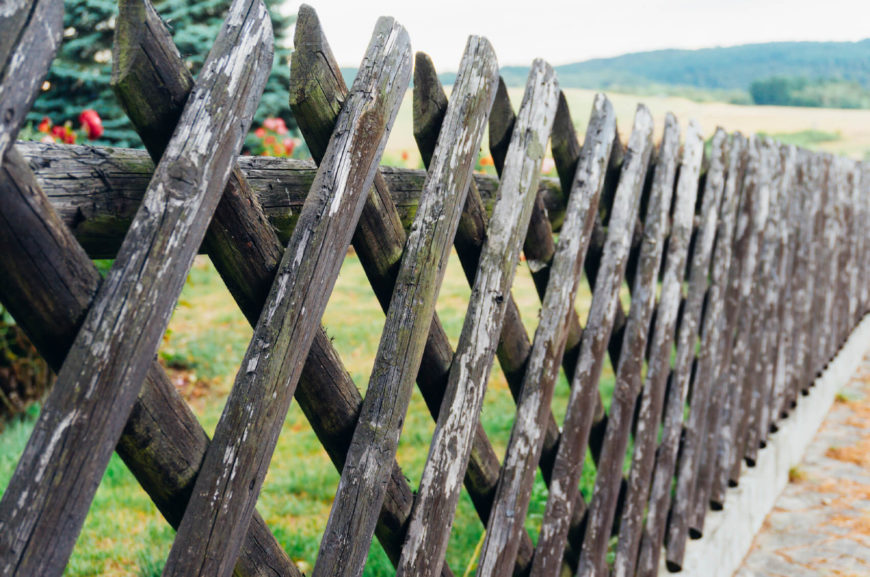 Wooden Fence Part - 38: A Stick Wood Lattice Fence Is A Good Old Style Design.