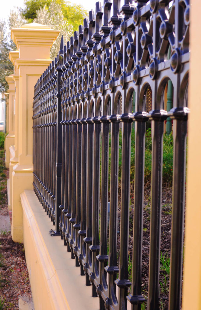Wrought Iron Fence Design 32 elegant wrought iron fence ideas and designs a classic wrought iron design is incorporated into this mixed material fence workwithnaturefo