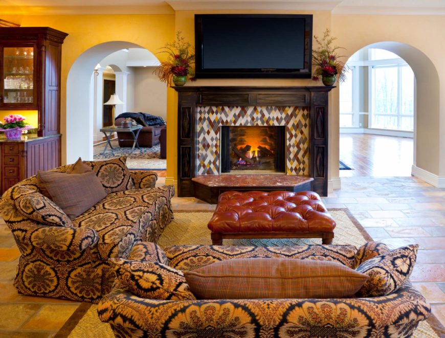 A Lovely Tile Mosaic Outlines This Fireplace, Which Serves As The  Centerpiece To This Living