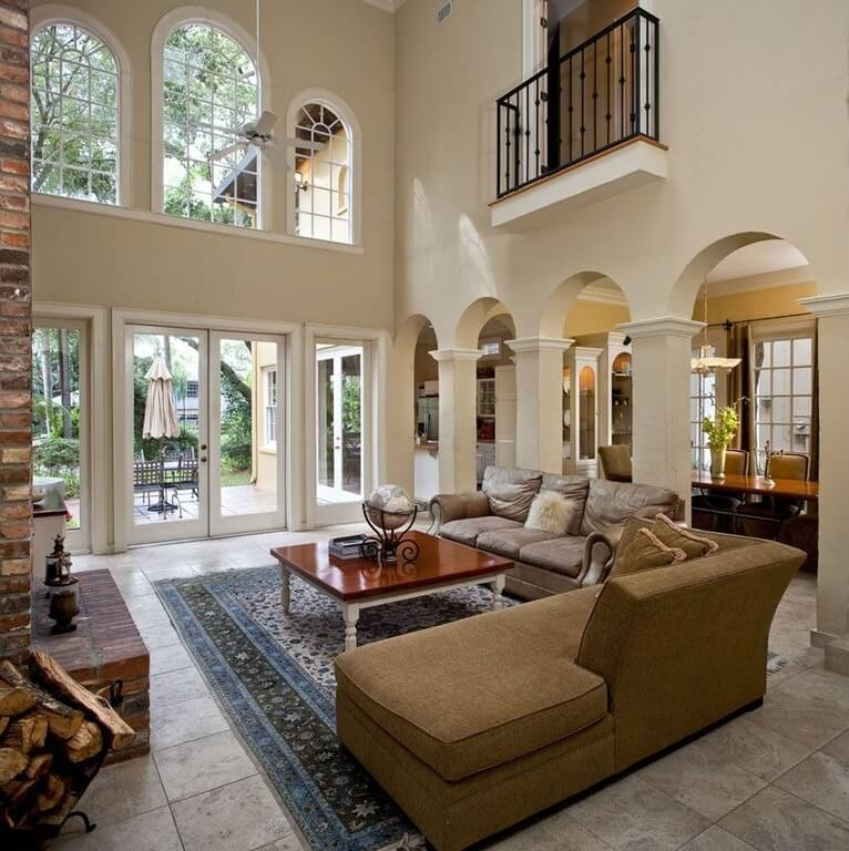 A Line Of Multiple Wide Archways And Multiple Levels Of Windows Give This  Space A Very