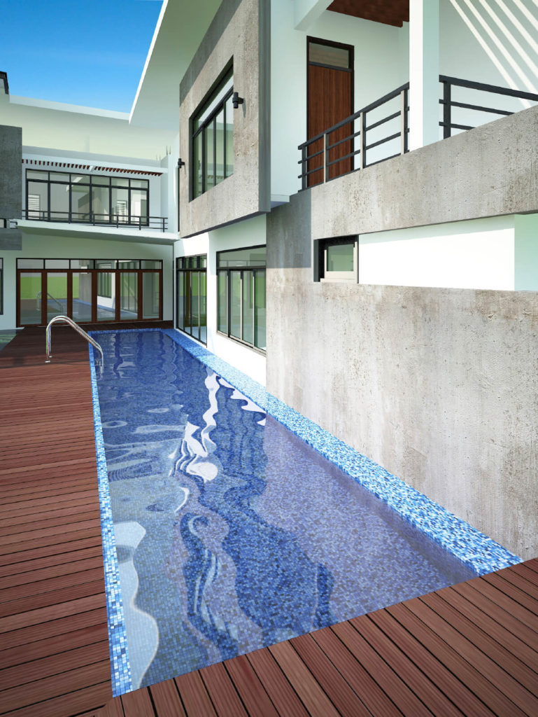 This pool is tucked between the home and the deck. It is a clever use of space, stretching the pool longer while keeping it relatively thin. This way there can be some semblance of length without taking up much more square footage.