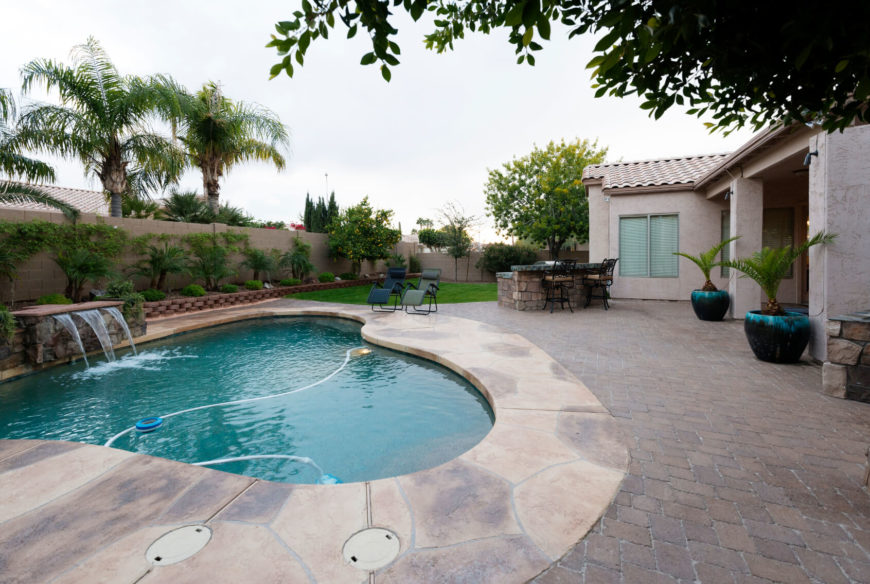 Attractive This Asymmetrical Pond Style Pool With Waterfall Is An Amazing Small Pool. The  Shape Allows Amazing Pictures