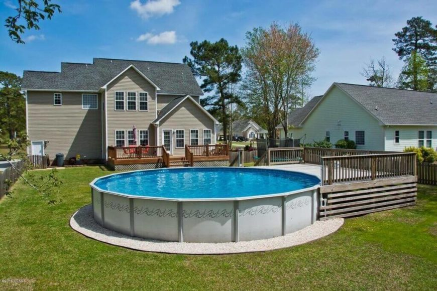 this round above ground pool has a small deck on one end but other