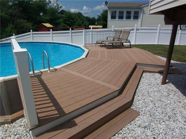 Above Ground Swimming Pool Design This above ground pool is built uneven ground, and uses that to extend a  deck