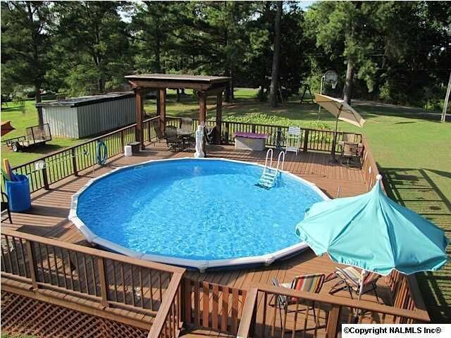 here we see another deck all the way around a round above ground pool - Above Ground Pool Deck Off House