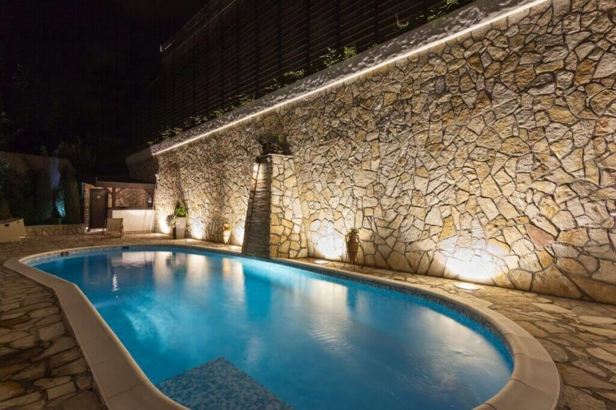 This is a small version of a kidney shaped pool, with a wonderful lighting scheme.