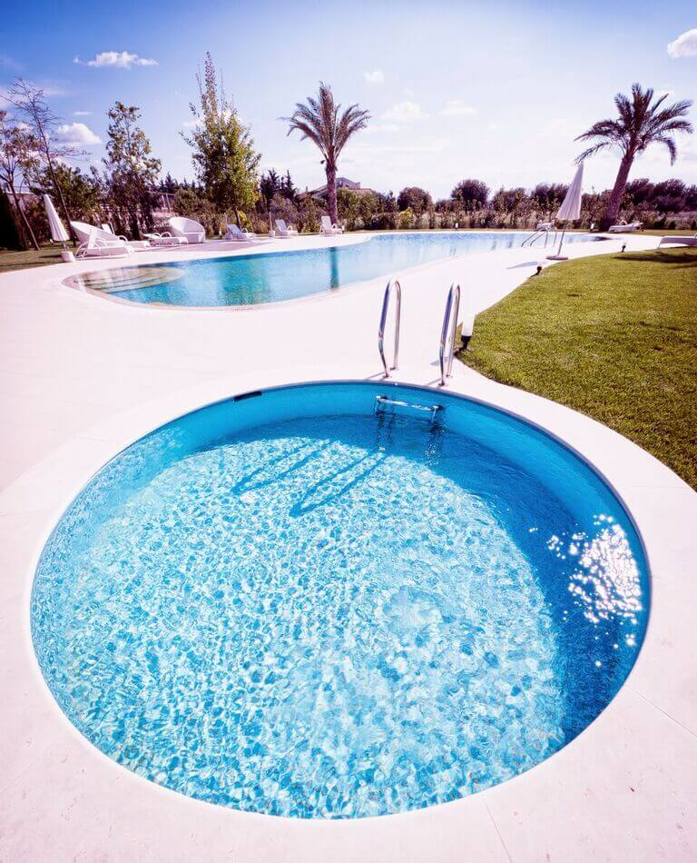 This is a small circular pool, next to a larger figure eight style pool. The round pool is nice for a smaller side pool for children, as the larger pool may be deeper for adults.