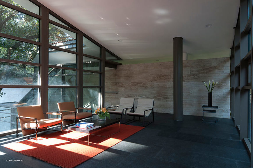 Here's a look inside the massive open space at the center of the home, with the rich marble walls seen at center. The full height windows spanning the structure allow in plenty of natural light and passive heat.