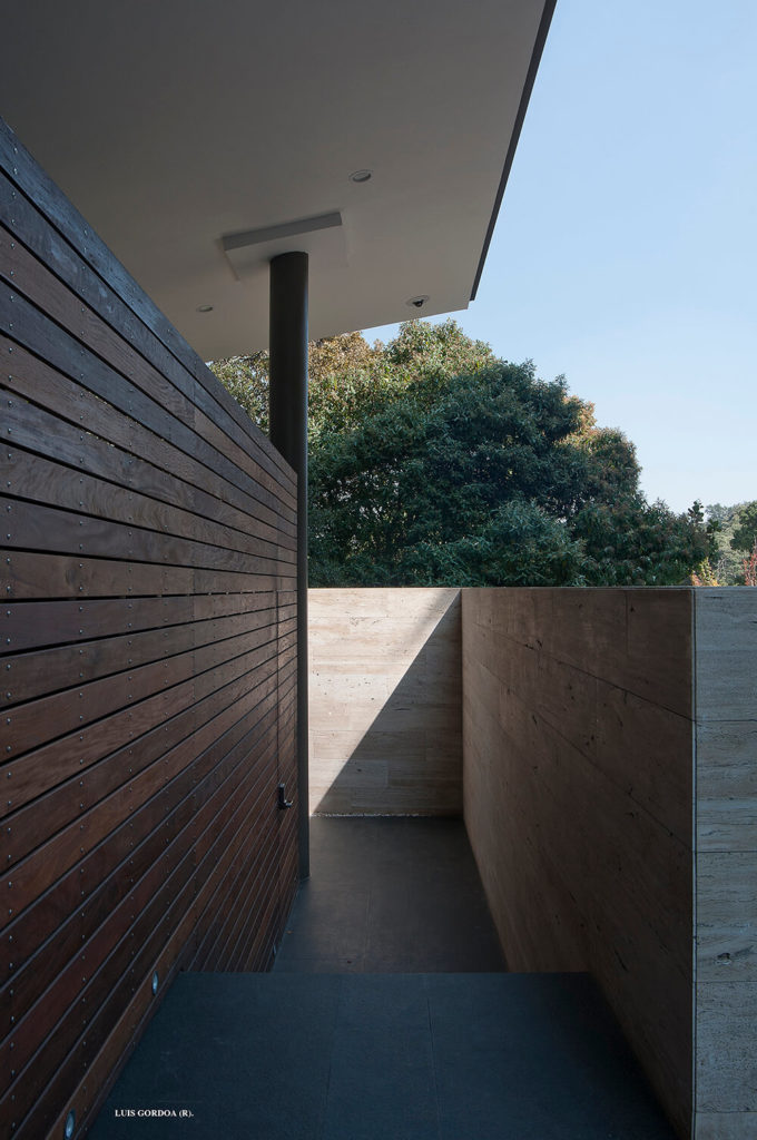 The home utilizes the heavily sloped and forested landscape to its advantage, sinking into the space and becoming one with the environment.