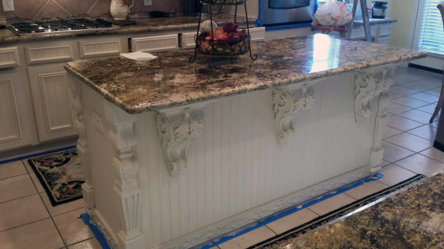 Here's a look at the kitchen island in the process of being antiqued. The wood work has been done, and the new granite countertop is in place, but the textural antiqued look has yet to be implemented.