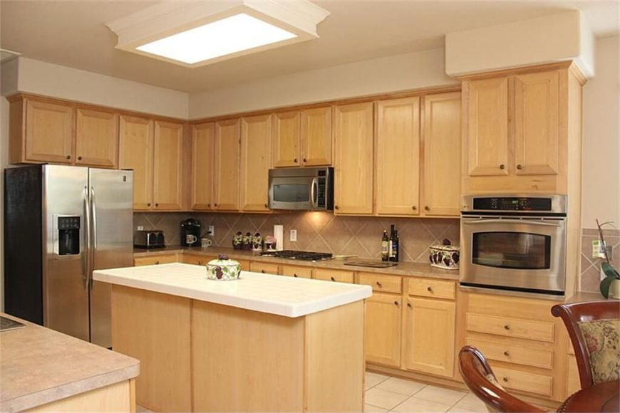 Here's the kitchen before the renovation. It's a perfectly nice space, but nothing special. The cabinetry in particular is pretty neutral and unmemorable. The renovation completely changed this room.