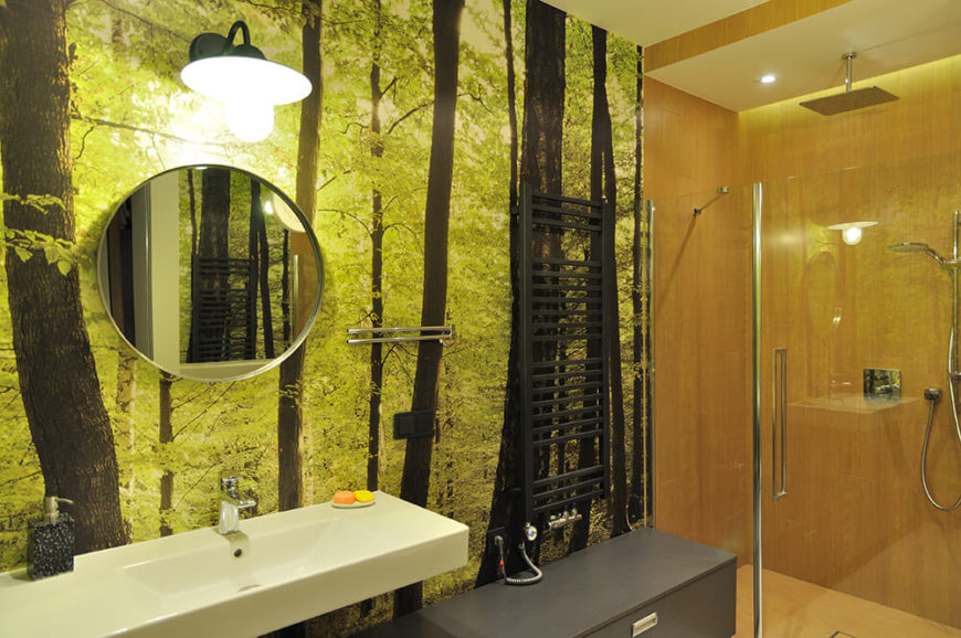 The children share a bathroom with an incredible photo wall and glass shower. Wood-look tile continues the natural look of the room.