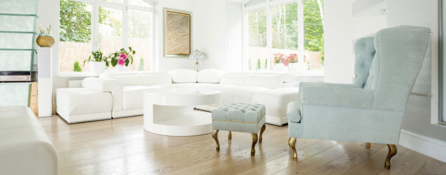 this blue accent chair is accompanied by a small matching ottoman both are elegant - Living Rooms With Ottomans