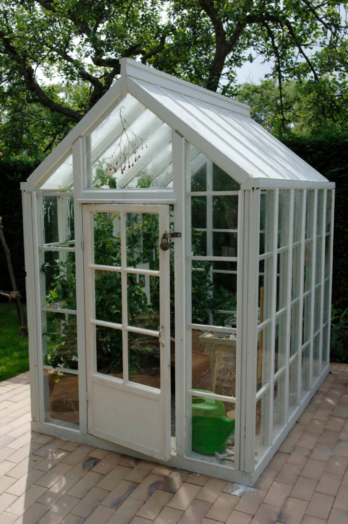 This is a small freestanding greenhouse without its own foundation. This would be a good greenhouse for a small garden, or if you had only a few plants that you wanted to grow. It does not take up much space, but is sturdy and gets the job done.