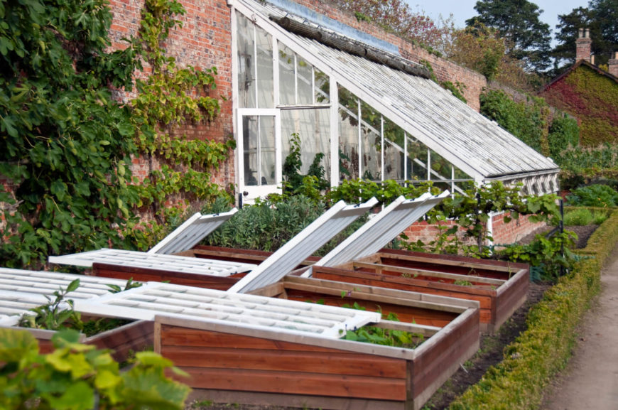 This Is A Good Example Of An Attached Greenhouse With A Sturdy Brick Base.  In