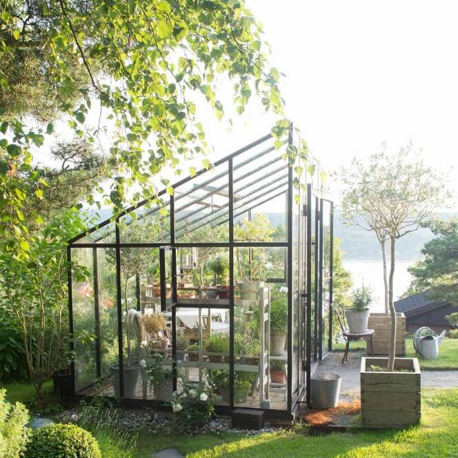 This greenhouse has an interesting and clever design, angled to make the most use of the space and to get the optimal amount of light to the plants that need it.