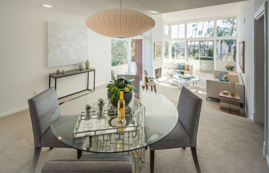 Elegant Contemporary Dining Room With A Glass Top Table