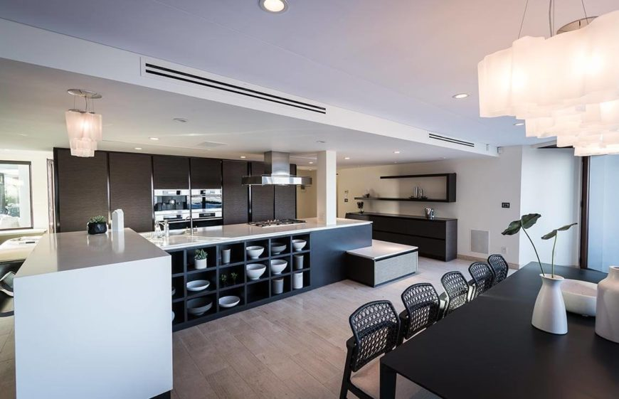 This beautiful kitchen is clear and very clean. You can see how the natural light makes the kitchen very attractive. The light plays off of the beautiful stainless steel appliances. These appliances give this already clean kitchen a sleek and ultra modern look.