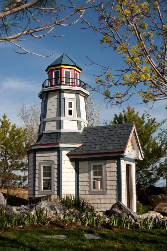 Lookout for fun in this Cape Cod style lighthouse building! Complete with light tower and circling balcony, this charming structure is a sea-loving child's dream.