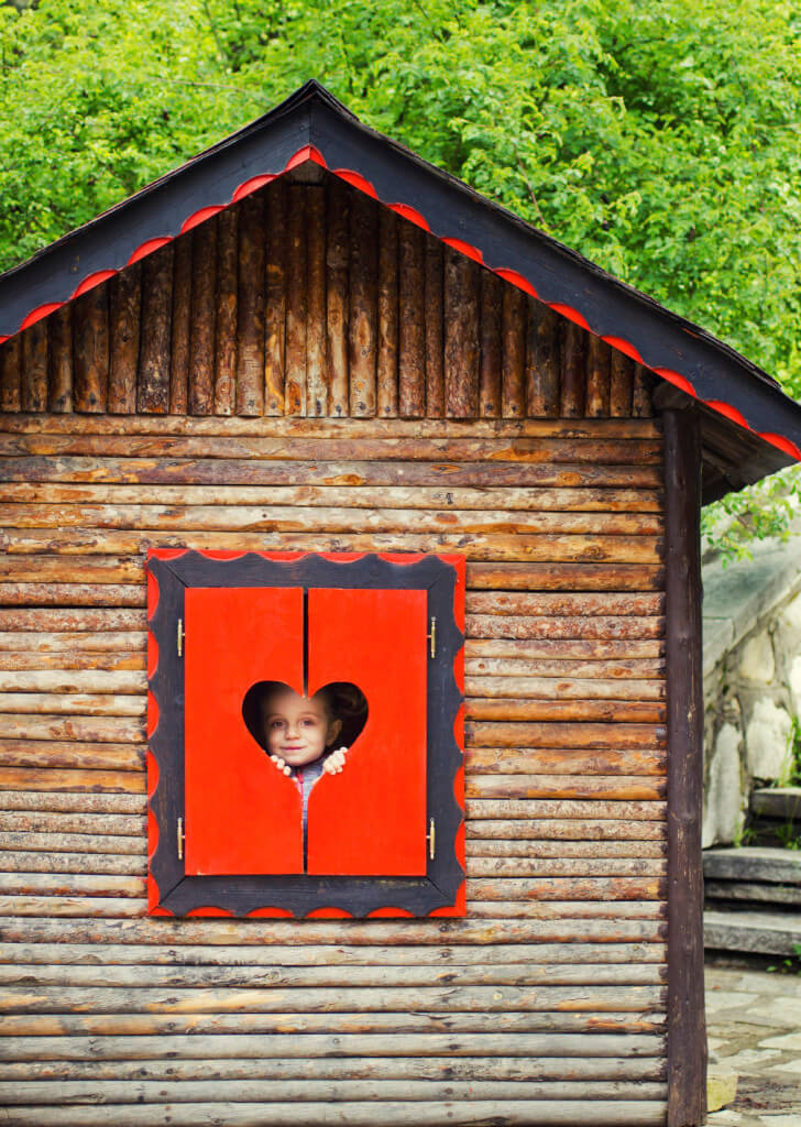 Cute heart window cutouts and a complementary gingerbread trim make this log cabin style playhouse unique. You can experiment with all different kinds of trims and borders to add pizazz to any playhouse.