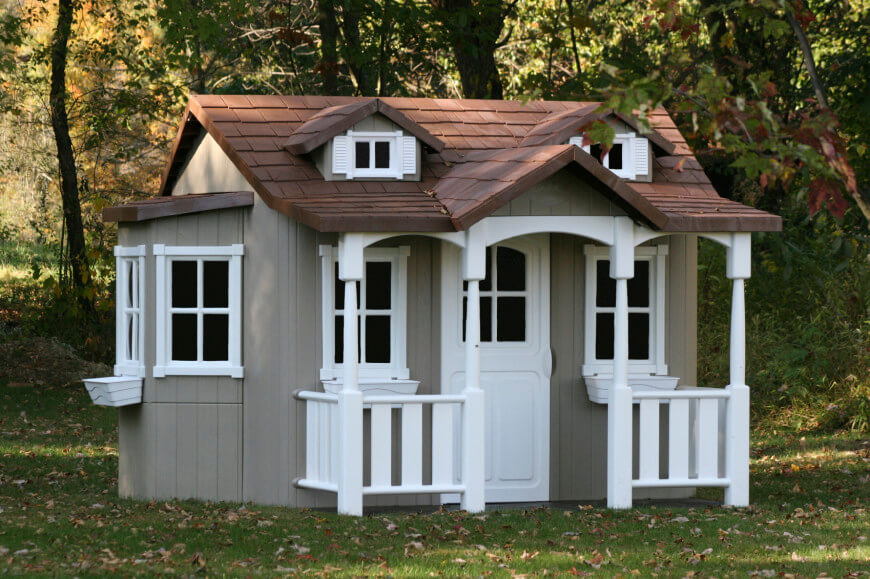 This more elaborate plastic house provides the quaintness of a wooden house with the durability of plastic, which makes it an excellent choice if you want to have a structure that looks realistic, without dealing with the maintenance issues of wood.