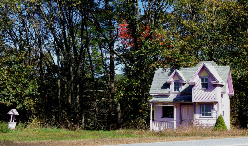 This pink Victorian two-story playhouse comes with a matching water well. The ornate woodwork and post work give this playhouse the style and charm characteristic of it's era.