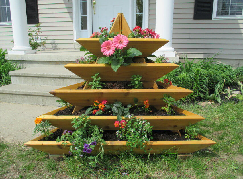 Here is an interesting multi-tiered raised garden bed unit. This is a prefabricated unit. This unit would is perfect for a small area where you want to build some visual interest and grow some beautiful flowers.
