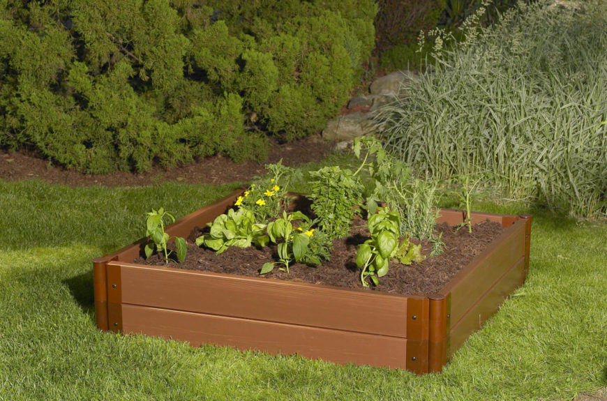 Here is an interesting, multi material raised garden bed. This is a prefabricated model, ready for any yard or garden area. This is the perfect garden bed if you are looking to grow a few vegetables in a yard with a little bit of space.