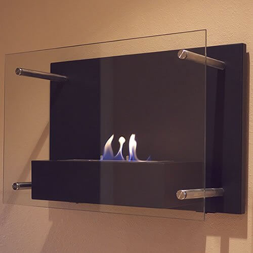 Did you know that you can have a more environmentally friendly fireplace? We were surprised ourselves. Units like the one pictured below run on bioethanol, a denatured alcohol also known by the term methylated spirits bioethanol. It's a completely renewable energy source made from the fermented sugar and starch components of plant byproducts, including sugarcane, corn, potatoes, milk, rice, and even grapes and other fruits. The combustion of bioethanol is so clean that you can completely ditch the chimney and flue, keeping heat directly in the room. There is no smoke to speak of, and it's leagues safer than a standard wood burning fire.