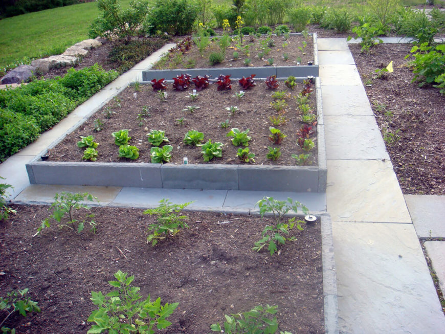 Concrete is a great material that can make a flower bed with a thin profile so that the edges do not take up much space. Even when thin, concrete is quite strong, and can withstand a great deal of abuse before giving way.
