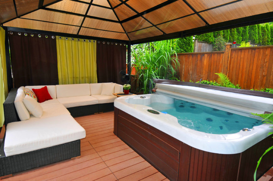 Here is a nice area that is enclosed with curtains, and has a lovely sofa next to the hot tub. This area can be private and secluded, or open wide to the worlds, but there is always ample room for people to sit in and out of the hot tub.