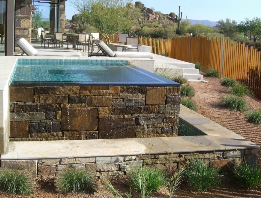 An infinity edge is a great way to make any body of water look sleek and modern. This is an example of an infinity edge that has a updated, sleek and up-to-date appeal.