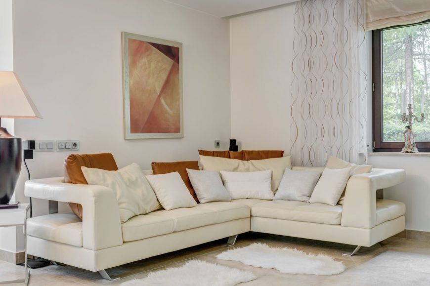 This is a sectional sofa with an interesting and modern design. A sectional provides more seating for occupants. This sofa has a visually interesting design which adds to the modern appeal of the room.