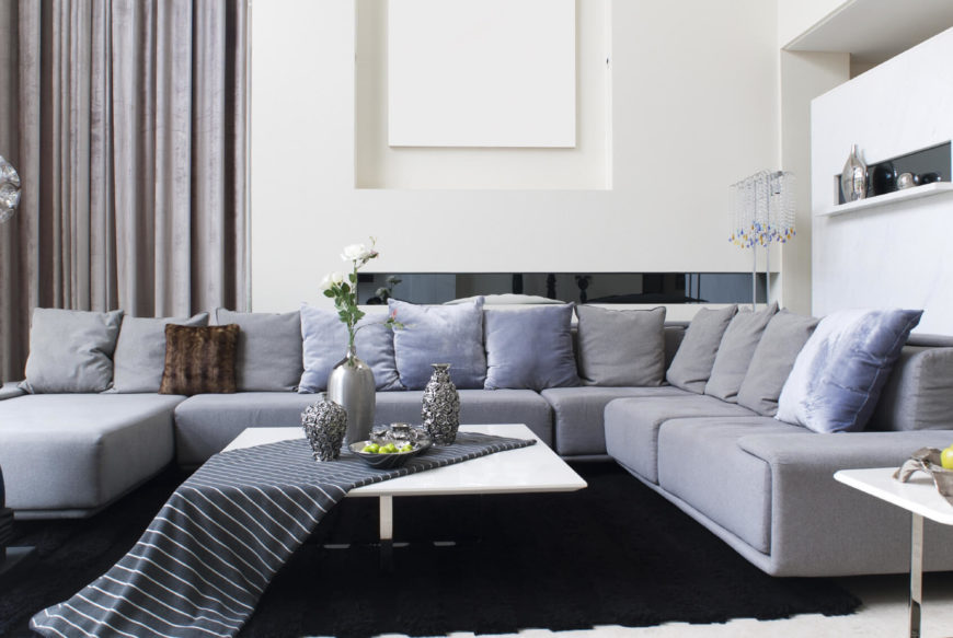 In this living room we see a large sectional sofa that has an attached chaise lounge.