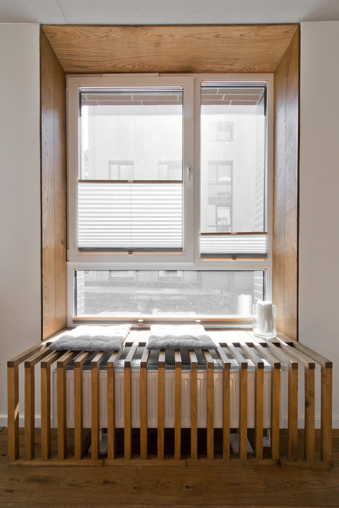 Here's a closer look at the unique window frame extension, a series of thin slats that provide both aesthetic cover for the radiator as well as a small window seat bench.