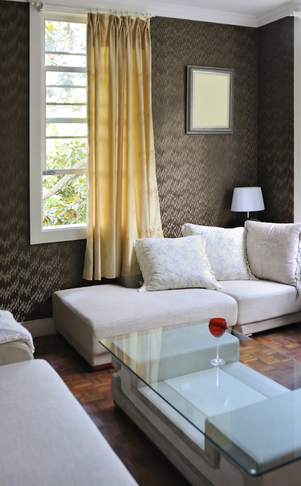 Wallpaper is a less common design element today, but the right textured wallpaper can make a big difference in a room with muted furniture and lots of glass.