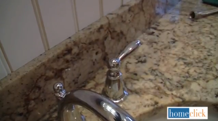 Next, you're going to insert the supplied hot and cold screws - hot on left, cold on the right of course. Now you're well on your way to having a brand new faucet. Now you're ready to put those nice new handle on the sink and insert the stem of the spout