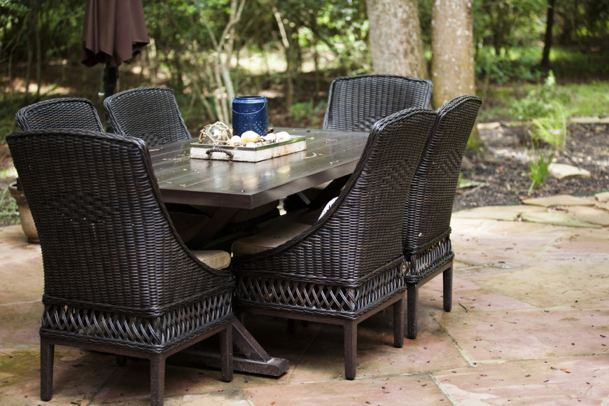 Here is a dark wooden table with a number of chairs around it. Picnic benches typically don't have padding on the seats. If you need padding for your chairs you can use outdoor chairs to add to the seating of a picnic table.