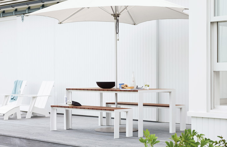 This picnic table and paired benches have a thin and minimalistic design. This is an amazing sleek design that makes very little impact on your space while still providing a great place to eat outside.