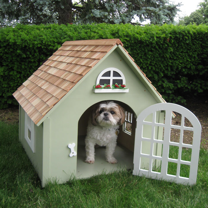 This small, adorable dog house has a miniature fake window and window box above the door, which can be locked if the dog needs to be corralled for a short while.